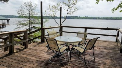 Waterfront deck with seating and panoramic views