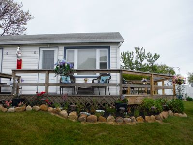 View of Cottage and new garden. Wrap around deck is great for relaxing.