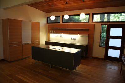 The kitchen is equipped with cabinetry from Bultaup.