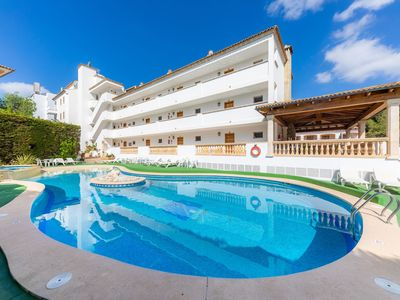 Photo for Apartment Close to the Beach with Pool Access, Private Terrace, Air Conditioning and Wi-Fi