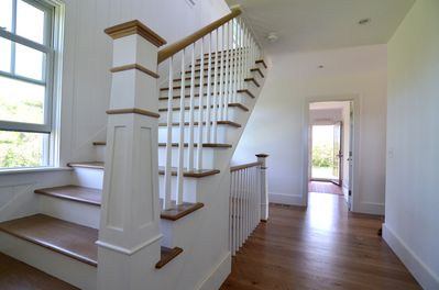 Newly renovated front hallway includes wide staircases and lots of natural light