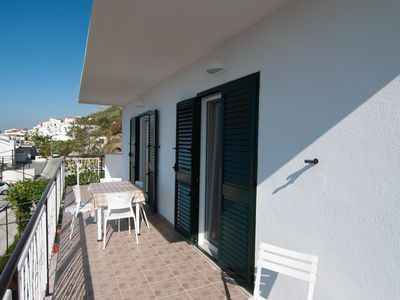 Photo for One bedroom apartment with terrace and sea view Pisak (Omiš)