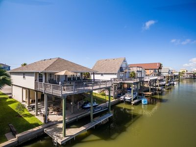 Beautiful Canal home, short walk from beach! Pet friendly, WiFi, new Boat Sling