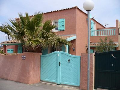 Photo for Our vacation home is located on the promenade & on the beach of Gruissan.