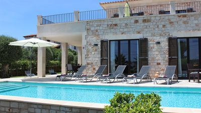 Photo for Cala Llombards: New villa with pool and sea view - 200 m to the beach