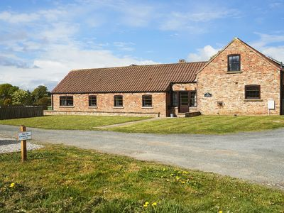 Photo for This is a light and spacious barn conversion of mellow North Yorkshire brick.