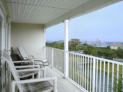 Photo for 4th Floor Condo Offers Tropical Style Furnishings & Balcony for Breathtaking Sunsets!