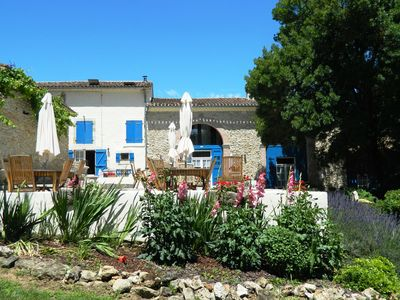 Photo for French farmhouse with beautiful renovated gite with pool in the South of France