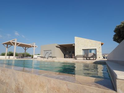 Photo for Holiday Spiti Karma - relax by the pool overlooking the sea, plain and mountains.
