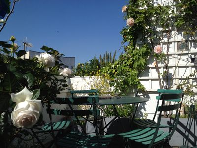 Photo for Apartment with south facing terrace not overlooked, center of Paris, charm