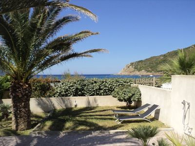 Photo for Small detached villa F3 75m² + loggia directly on the beach of the Gulf of Lava