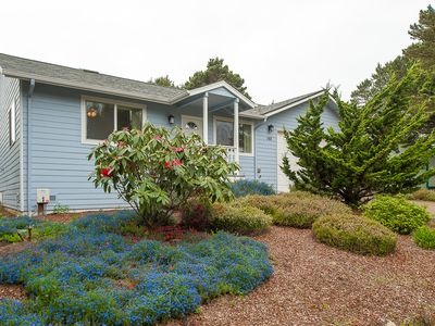 Photo for Explore Beverly Beach in this charming three bedroom moments from the beach!