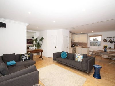 Photo for 2 bed apt with open plan kitchen. Less than a minute walk to the tube! (Veeve)