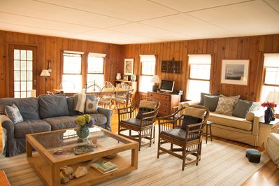 Main house living area has 2 couches, a day bed, and dining table