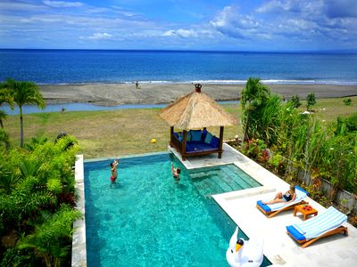 Photo for Feel the magic of bali in a luxury beachfront villa