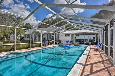 This home boasts a private pool and shaded patio within a screened lanai.