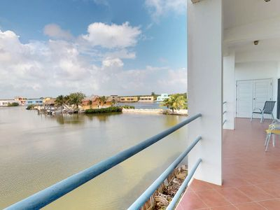 Photo for Water-front condo w/ocean views, shared pool - close to the beach!
