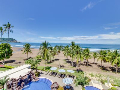 Photo for Upscale, beachfront condo with shared pool and spacious balcony!