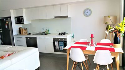 Fully equipped kitchen with oven, gas cooktop, microwave & coffee machine