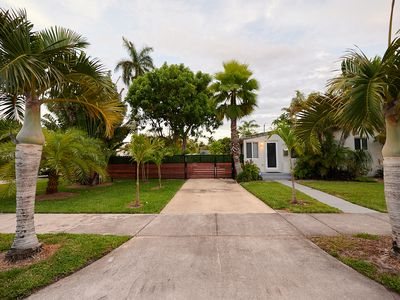 Photo for RESORT LIKE  HOME IN HOLLYWOOD BEACH  W/ HTD. POOL & HOT TUB  &  TROPICAL GRDN!