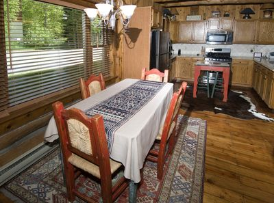 Cozy log cabin town home, with a decor flare of the West!