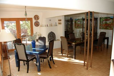 The dining area with french doors to the garden.