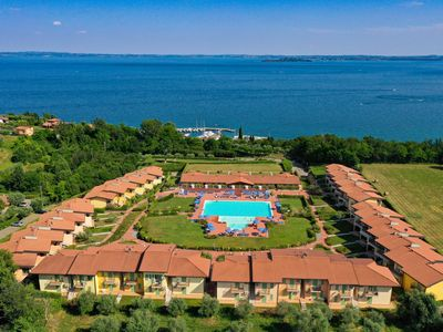 Photo for Full Lake View within famous Montecolo Resort! Pools, beach volley, football, playground, BBQ area!