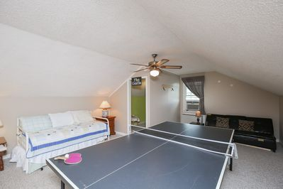 Game Room - The game room has a full-size ping pong table, twin day bed with trundle, futon couch, and kids' toys
