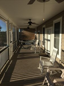 Listen to the waves from your front porch.  Huge hammock with rocking chairs!
