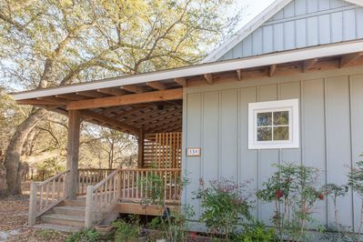 3 steps up to private entrance and covered porch