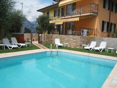Photo for Apartment with pool immersed in the tranquility of the olive trees near the lake