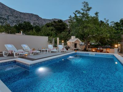 Photo for Holiday house with pool and beautiful garden with sea view, quiet location above the coast