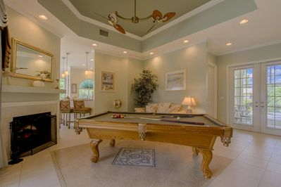 Directly when entering the front door, one is greeted by a standard size pool table