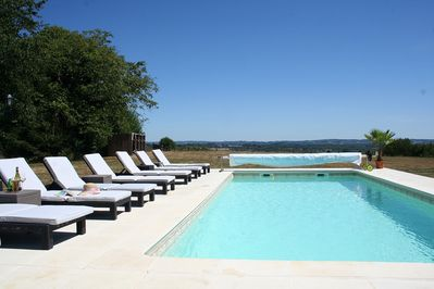 Swimming pool and sun terrace with panoramic far reaching views