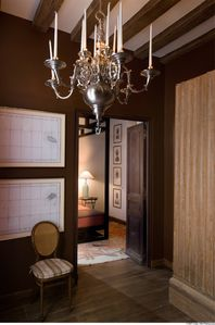 Entry Foyer with Dutch-style chandelier, armoir & double-door to master bedroom