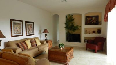 Photo for Elegant, spacious, open design. 4/3 Pool Home with game room at Grand Reserve. Lakes, golfing, natur