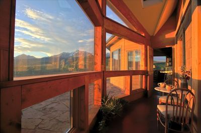 A breezeway overlooking a terrace, and simply stunning views of the San Juans...