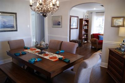 Dining room table with plenty of seating opens to living room.