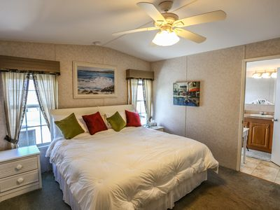 Welcome to 36 Emily Lane, a 2 bedroom, 2 bath canal-front manufactured home located on the mainland just a short 2-3 minute drive from Fort Myers Beach