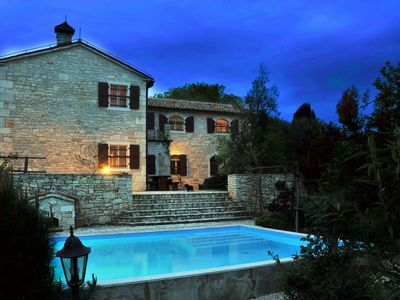 Photo for Beautiful detached villa with pool in the village of Kapovici near St. Lovrec