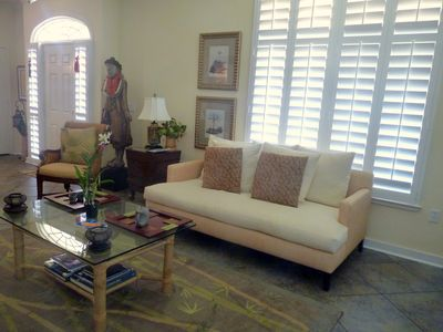 Living room with tranquility statue and leis