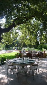 Shaded terrace dining with 2 corner seating areas