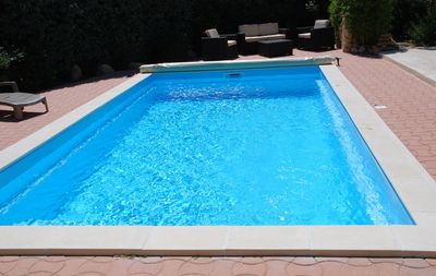 pool cover conforms to strict french law and keeps the pool warm and clean