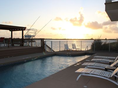 Photo for Cozy Condo w/pool & deck overlooking the water, walking distance to the beach!