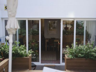 Photo for Charming apartment in the centre with garden