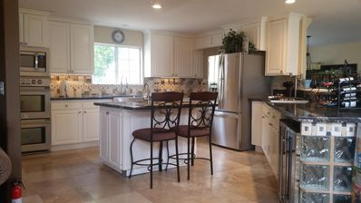 This large gourmet kitchen is the heart of the home!