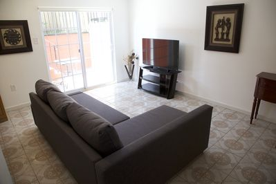 Large living-room area with Cable TV and comofortable sleeper couch
