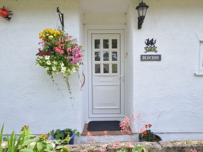 Photo for A quirky yet traditional cottage which has been renovated by hand using many reclaimed materials and