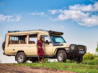Photo for A small boutique camp on the banks of the Mara River!