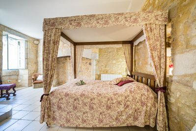 Our four poster bed in the main room.